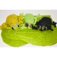 Knitted Frogs on Felt Mat