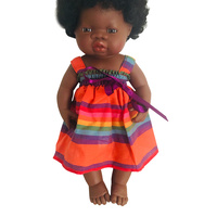 Doll dressed in Rainbow Stripe Bow Dress