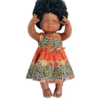 Doll dressed in Fire Dreaming Olive Dress